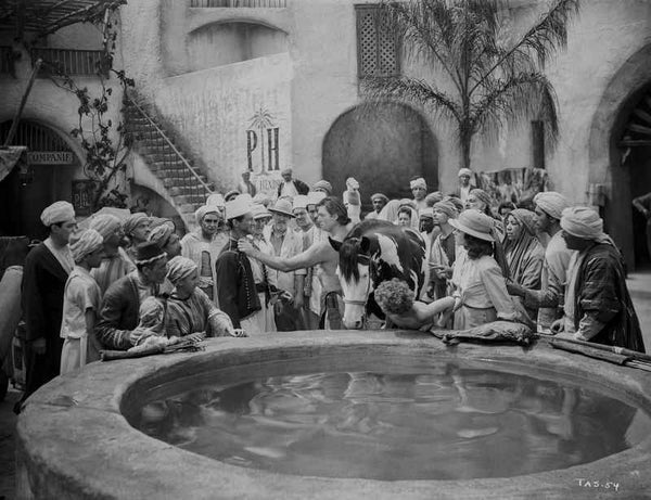Johnny Weissmuller Picking a Fight Near the Well in a Movie Scene Premium Art Print
