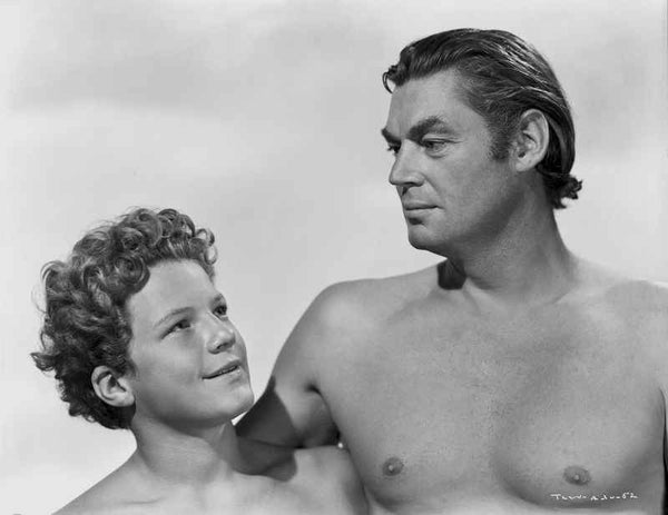 Johnny Weissmuller Putting His One Arm on a Kids Shoulder in a Portrait Premium Art Print