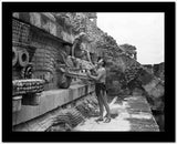 Johnny Weissmuller Talking to a Woman on Top of the Dragon Head Wall Decoration in a Classic Movie Scene High Quality Photo