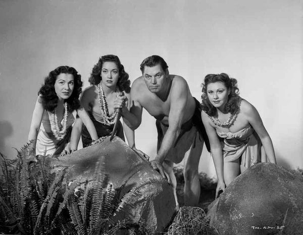Johnny Weissmuller Kneeling on the Ground with Three Woman in a Classic Movie Scene Premium Art Print
