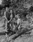 Johnny Weissmuller Holding Hands with a Woman in a Classic Movie Scene Premium Art Print