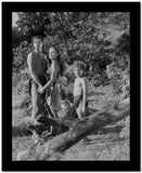 Johnny Weissmuller Holding Hands with a Woman in a Classic Movie Scene High Quality Photo