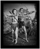 Johnny Weissmuller Leading a Young Man to Shoot His Arrow in a Classic Movie Scene High Quality Photo