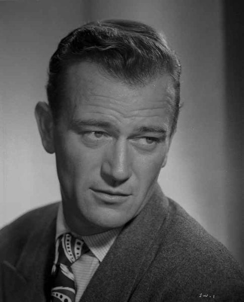 John Wayne wearing a Suit and a Detailed Necktie while Looking Away Premium Art Print