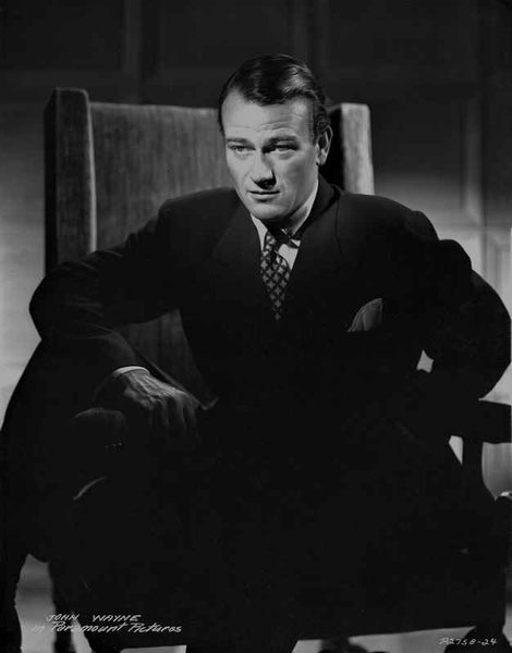 John Wayne sitting in suit and tie Premium Art Print
