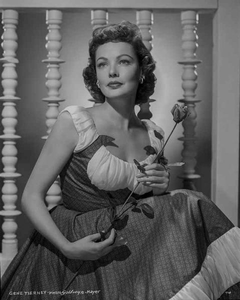 Gene Tierney Holding Flower in Dress Premium Art Print