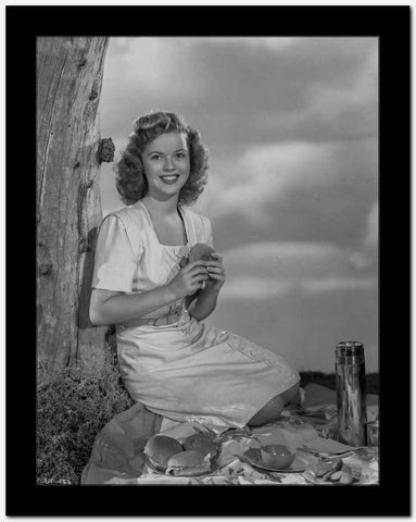 Shirley Temple Kneeling on the Ground and Leaning on a Tree High Quality Photo
