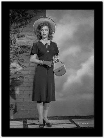 Shirley Temple wearing a Black Dress with Matching Hat High Quality Photo