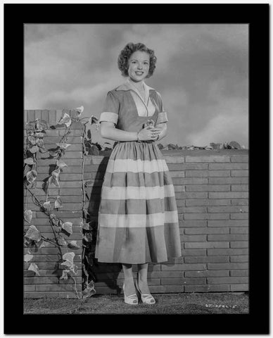 Shirley Temple standing in Bricks Background High Quality Photo