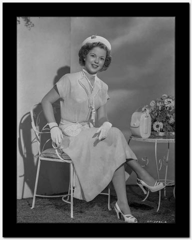 Shirley Temple sitting on a Chair and wearing a Wrap Dress High Quality Photo