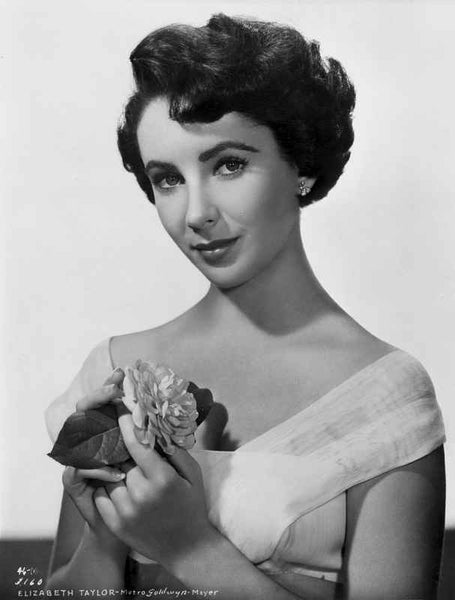 Elizabeth Taylor Holding Brooch in Gown Premium Art Print