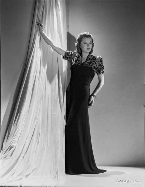 Barbara Stanwyck Leaning Pose in Long Black Gown Premium Art Print