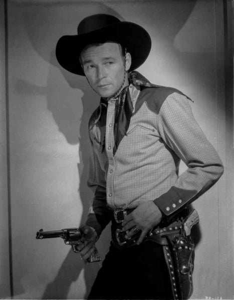 Roy Rogers Leaning on Wall and Holding a Revolver Premium Art Print