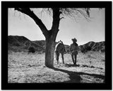 Roy Rogers standing with A Horse in Black and White High Quality Photo