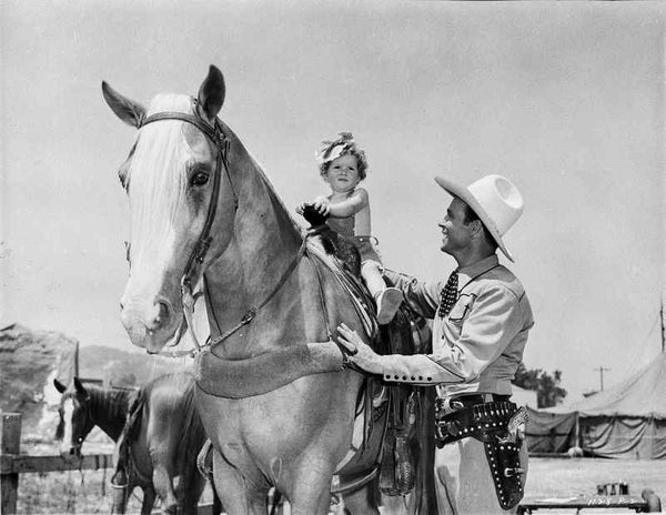 Roy Rogers smiling with A Little Girl and A Horse Premium Art Print