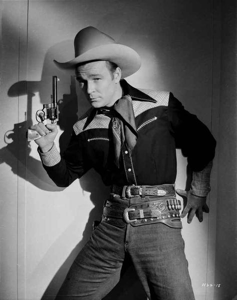 Roy Rogers posed in Cowboy Outfit Holding a Revolver Premium Art Print
