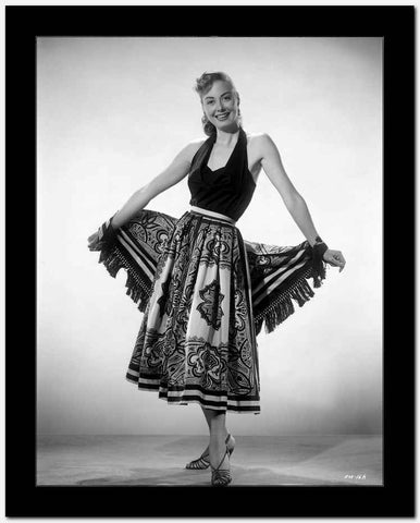 Adele Mara on a Printed Skirt posed and smiling High Quality Photo