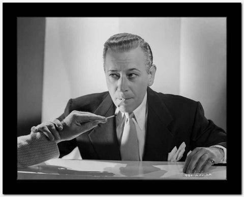 George Raft in Black Suit Lighting a Cigarette High Quality Photo