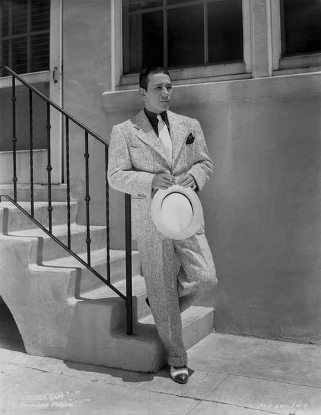 George Raft Leaning on Stair Railing in Formal Outfit With Hat Portrait Premium Art Print