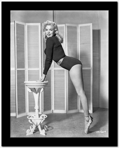 Jayne Mansfield Posed and Bent Over in Black Long Sleeve One Piece Sexy Suit and Silk Waist Belt with Hands on the Table High Quality Photo