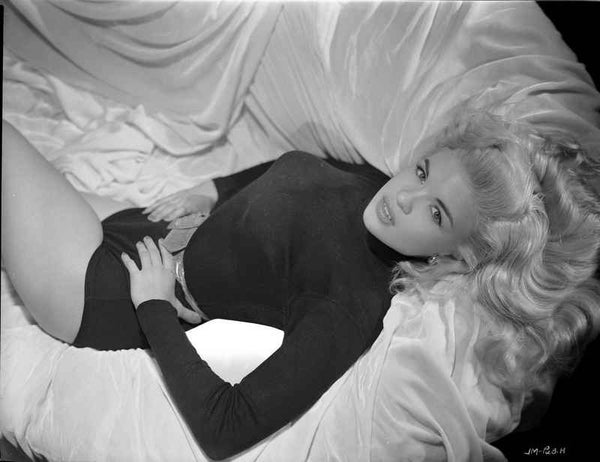 Jayne Mansfield Posed in Black Long Sleeve High Neck Shirt and Leather Waist Belt with Hands on the Waist Premium Art Print