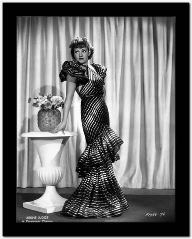 Arlene Judge on a Stripe Gown and Leaning High Quality Photo