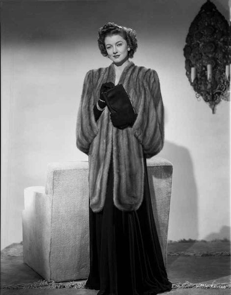 Myrna Loy standing in Robe with Gloves Premium Art Print