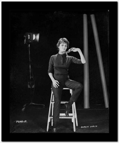 Sophia Loren sitting on a Portable Ladder in a Portrait High Quality Photo