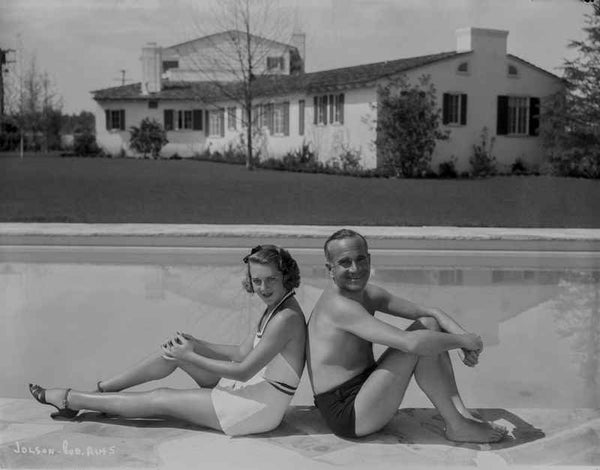 Al Jolson A Couple sitting on the Side of the Pool Premium Art Print