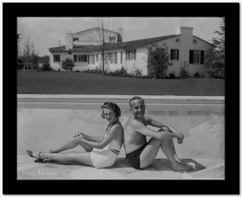 Al Jolson A Couple sitting on the Side of the Pool High Quality Photo