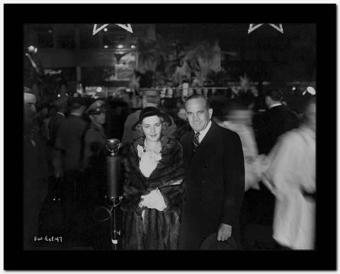 Al Jolson Accompanying a Woman in a Crowd in a Classic Portrait High Quality Photo