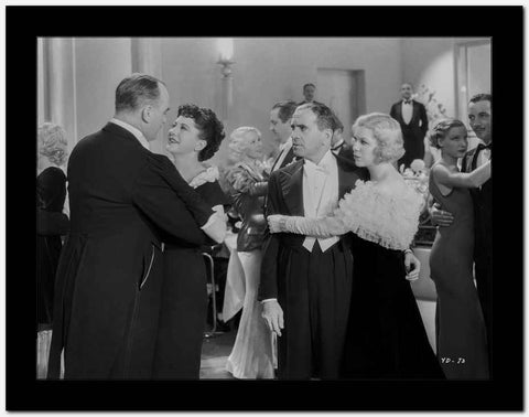 Al Jolson Dancing in the Hall with Other People in a Classic Movie Scene High Quality Photo