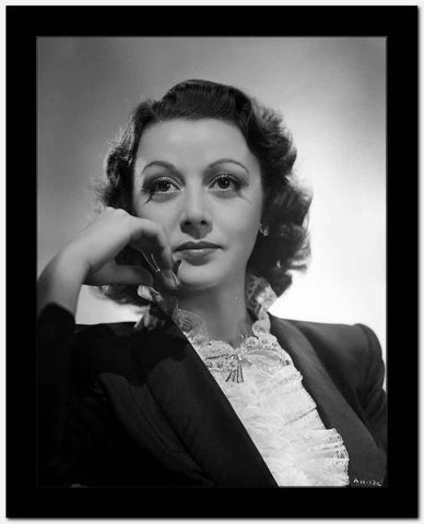 Ann Hunter on Blazer Leaning Cheek on Hand Portrait High Quality Photo