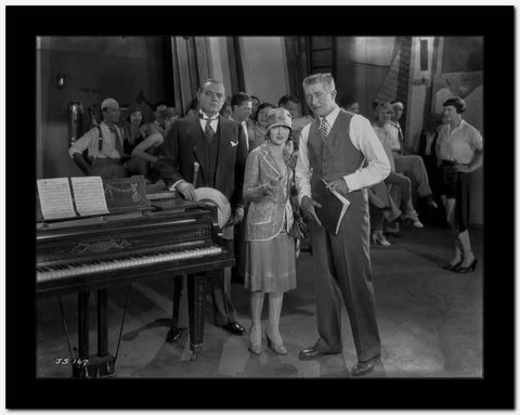 Al Jolson Discussing with His Group Near the Piano High Quality Photo
