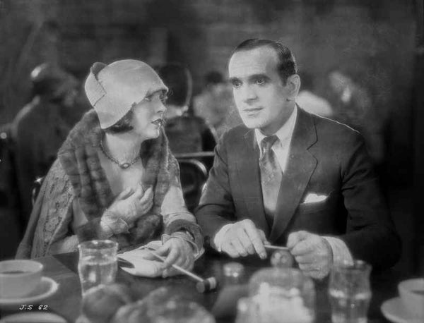 Al Jolson Eating with a Woman in a Restaurant in a Classic Movie Scene Premium Art Print