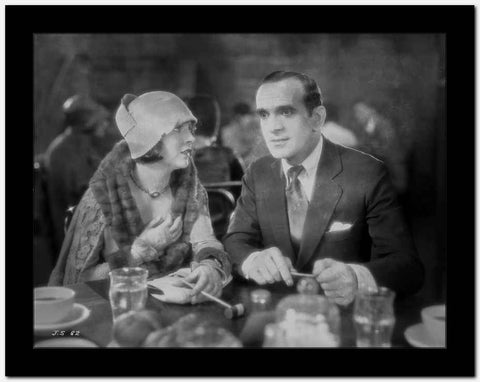 Al Jolson Eating with a Woman in a Restaurant in a Classic Movie Scene High Quality Photo