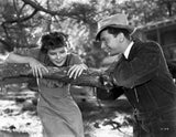 Katharine Hepburn Leaning on Tree with a Man Talking in Black and White Premium Art Print