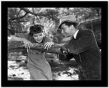 Katharine Hepburn Leaning on Tree with a Man Talking in Black and White High Quality Photo
