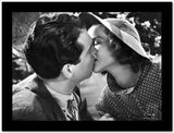 Katharine Hepburn with A Man Kissing High Quality Photo