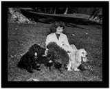 Katharine Hepburn Seated on Grass with Her Dogs High Quality Photo