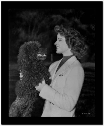 Katharine Hepburn in Black and White Portrait Face to Face with Dog High Quality Photo