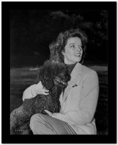 Katharine Hepburn Carrying a Puppy in White Dress High Quality Photo