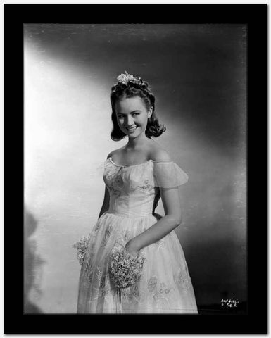 Ann Gillis on a Gown standing and smiling Portrait High Quality Photo