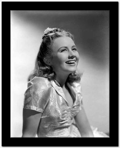 Ann Gillis wearing a Silk Top and smiling in Portrait High Quality Photo
