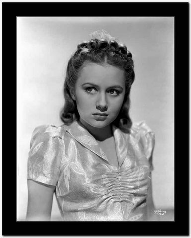 Ann Gillis Making a Lonely Face wearing a Glossy Blouse in Portrait High Quality Photo