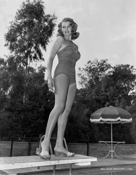 Rita Hayworth standing on Diving Board in Swimming Suit Premium Art Print