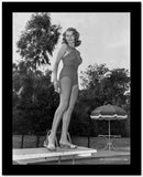 Rita Hayworth standing on Diving Board in Swimming Suit High Quality Photo