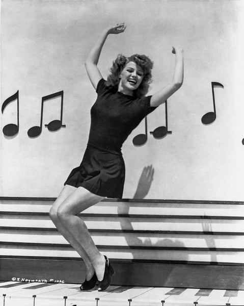 Rita Hayworth Dancing with a Musical Notes Background Premium Art Print
