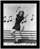Rita Hayworth Dancing with a Musical Notes Background High Quality Photo