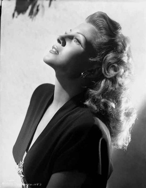 Rita Hayworth Looking Up in a Side View Pose Premium Art Print